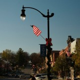 Flags flutter in the breeze off of lamp posts in downtown Plattsmouth, NE Saturday Nov. 12, 2016. (photo by Jerry L Mennenga©)