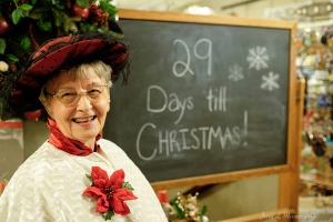 Counting down the days to Christmas, a woman greets visitors to a store during the Victorian Christmas on Main, Saturday Nov. 26, 2016, in Plattmouth, INE. (photo by Jerry L Mennenga©)